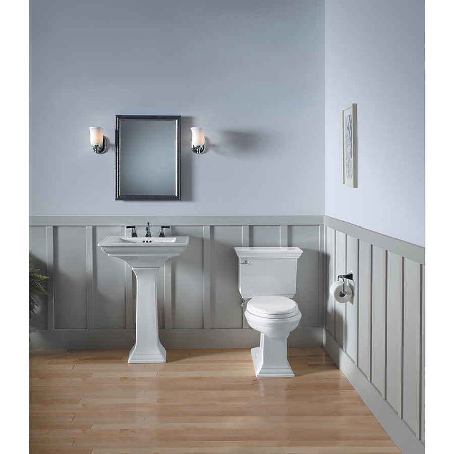 toilet and mirror in gray modern bathroom